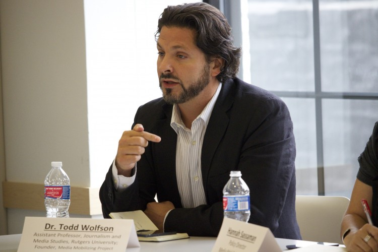Journalism and Media Studies Assistant Professor Todd Wolfson addresses FCC Chairman Tom Wheeler during a September roundtable discussion.